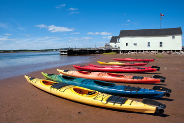 Colorful kayaks on the Prince Edward Island beach