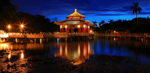 Chinese style pavilion in the night with reflection of light