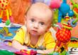baby plays in development gym