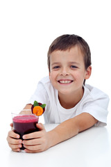 Happy healthy kid with fresh fruit juice