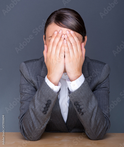 Portrait of tired business woman with face palm