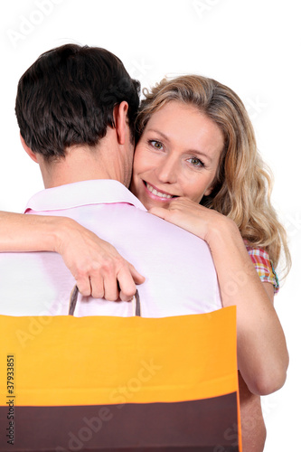 portrait of couple with bag