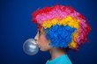 Young girl blowing bubble gum balloon