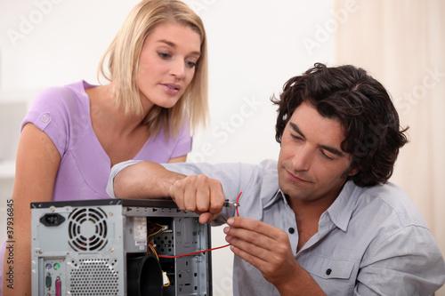 man repairing a computer