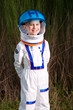 Happy boy dressed as an astronaut