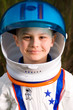 Cute young boy in an astronaut suit
