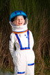 Boy in an astronaut suit laughing