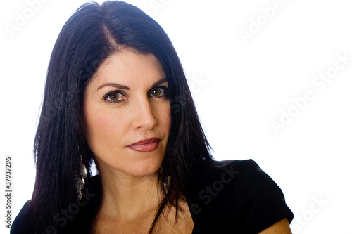 Beautiful middle aged woman with a stern expression
