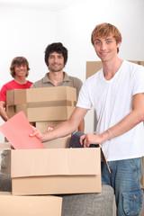 Three men moving house