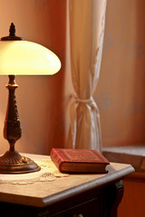 Old book and a lamp