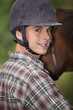 Portrait of a young horseback rider
