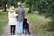 Older couple walking a dog