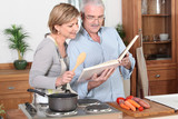 senior couple reading a recipe book