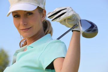 A portrait of a female golfer.