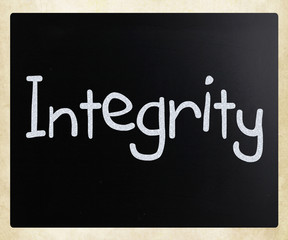 "The word ""Integrity"" handwritten with white chalk on a blackboar"