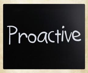 The word 'Proactive' handwritten with white chalk on a blackboar