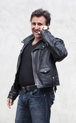 happy aging man with a black leather jacket