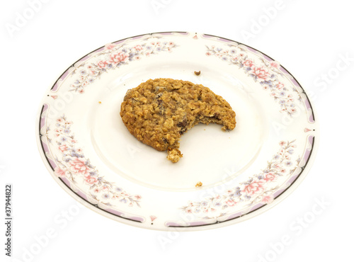 Bitten granola cookie on plate
