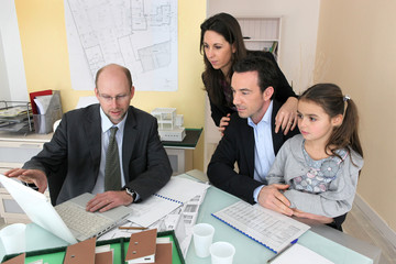 Family sitting in an architect's office