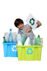 Little boy recycling
