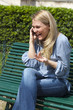 relaxed woman talking on the phone outdoors