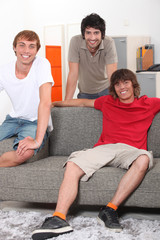 Housemates relaxing together in their sitting room