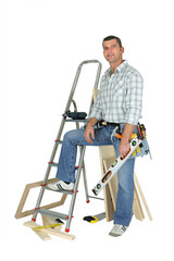 Carpenter stood with ladder and spirit-level