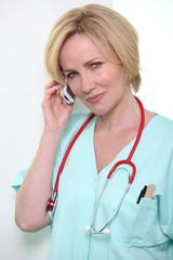 Hospital medic using a cellphone