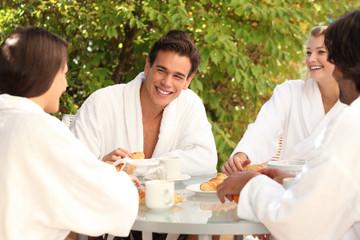 Friends having breakfast together in the garden