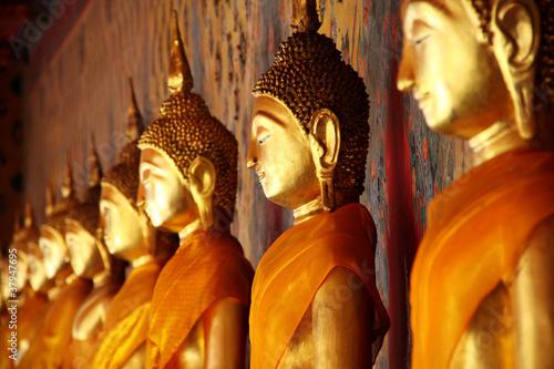 golden Buddha image arrange in arcade, Bangkok, Thailand