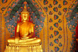 golden Buddha on painting wall, Bangkok, Thailand.
