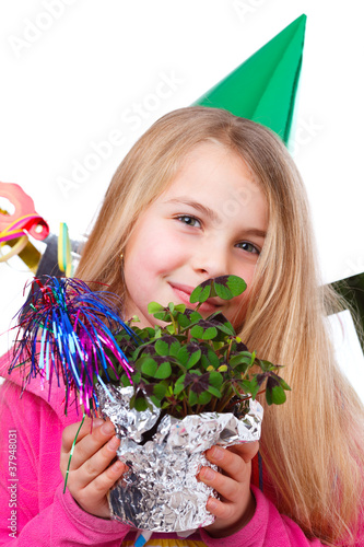 cute girl with party hat and four leaf clover