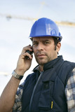 a workman at phone on a building site