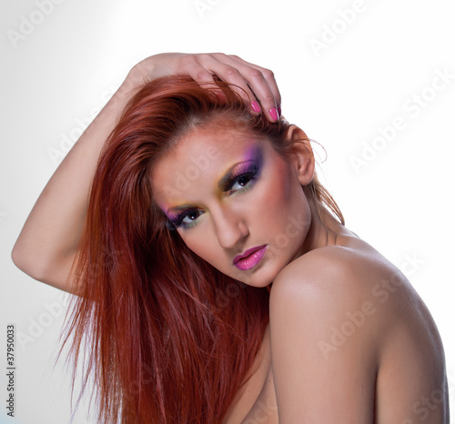 The beautiful young girl with red hair  looking steadfastly
