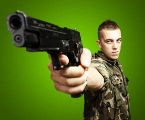 young soldier aiming with a gun