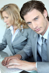 Businessman and woman on the computer