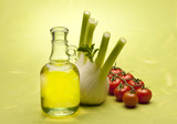 vegetable with olive oil on green background
