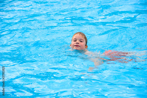 boy is swimming