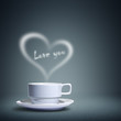 Coffee cup with heart shaped white smoke, love you