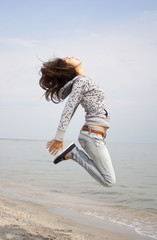 Young brunette pretty woman jumping