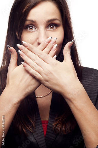 Young businesswoman covers her mouth