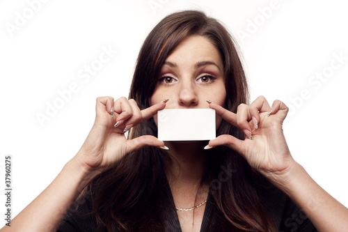 Young businesswoman holding empty blank over her lips