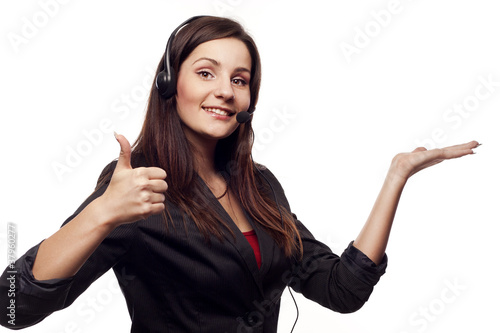 Woman operator with headset showing hand ok sign