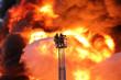 Leinwanddruck Bild - Feuerwehr vor Flammen