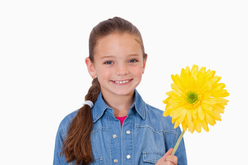 Girl holding a yellow flower