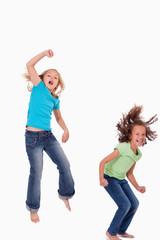 Portrait of girls jumping