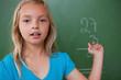 Little schoolgirl showing her result