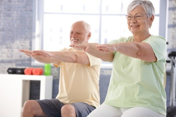 Mature people exercising happily