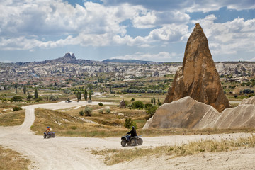 outskirts Goreme Uchisar backdrop Quad dirt riders