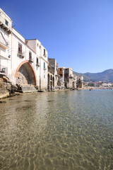 Crystal clear water on the medieval seafront at Cefalu